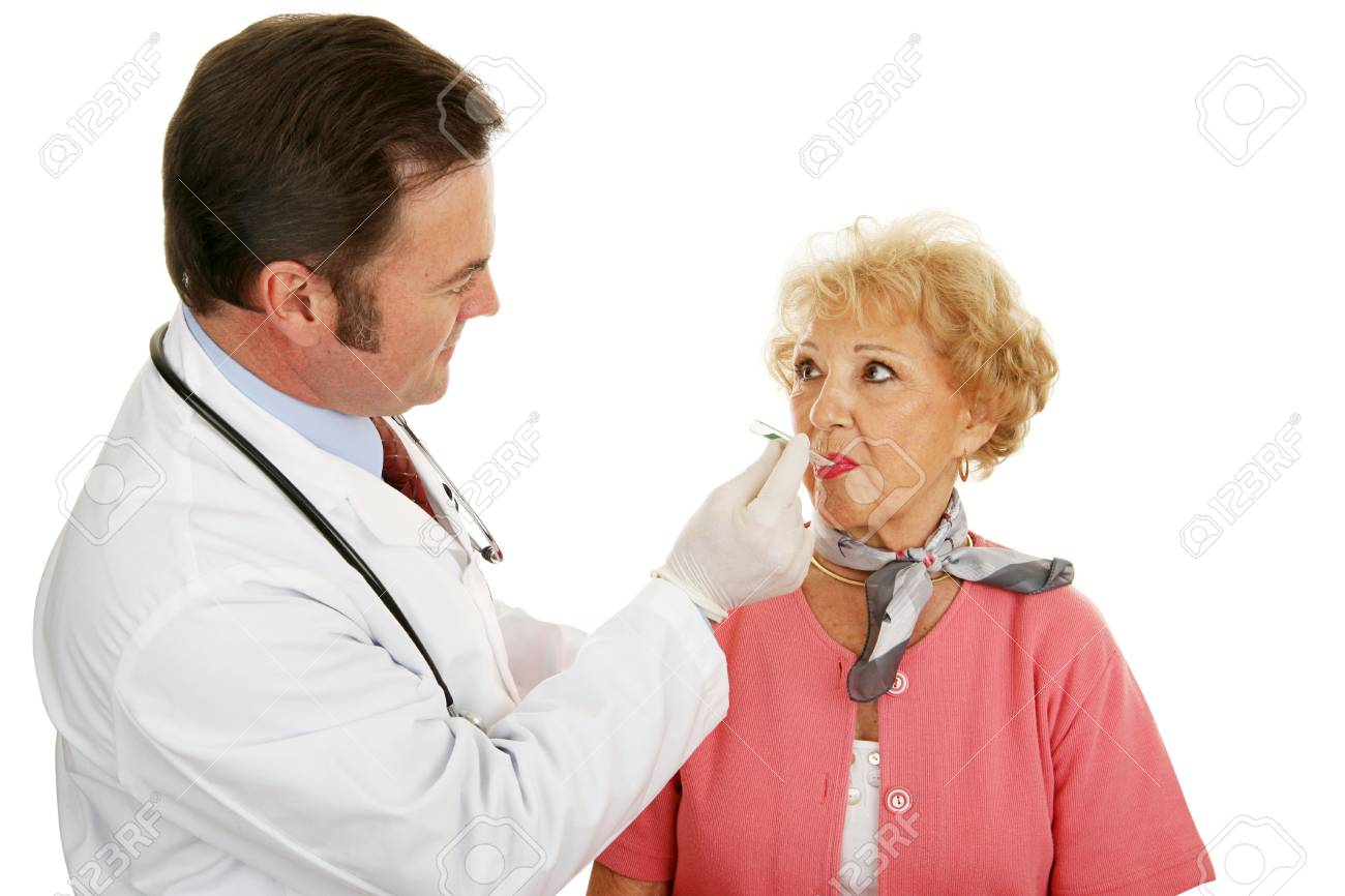 Senior woman at the doctor having her temperature taken.  Isolated on white. Stock Photo - 3190617