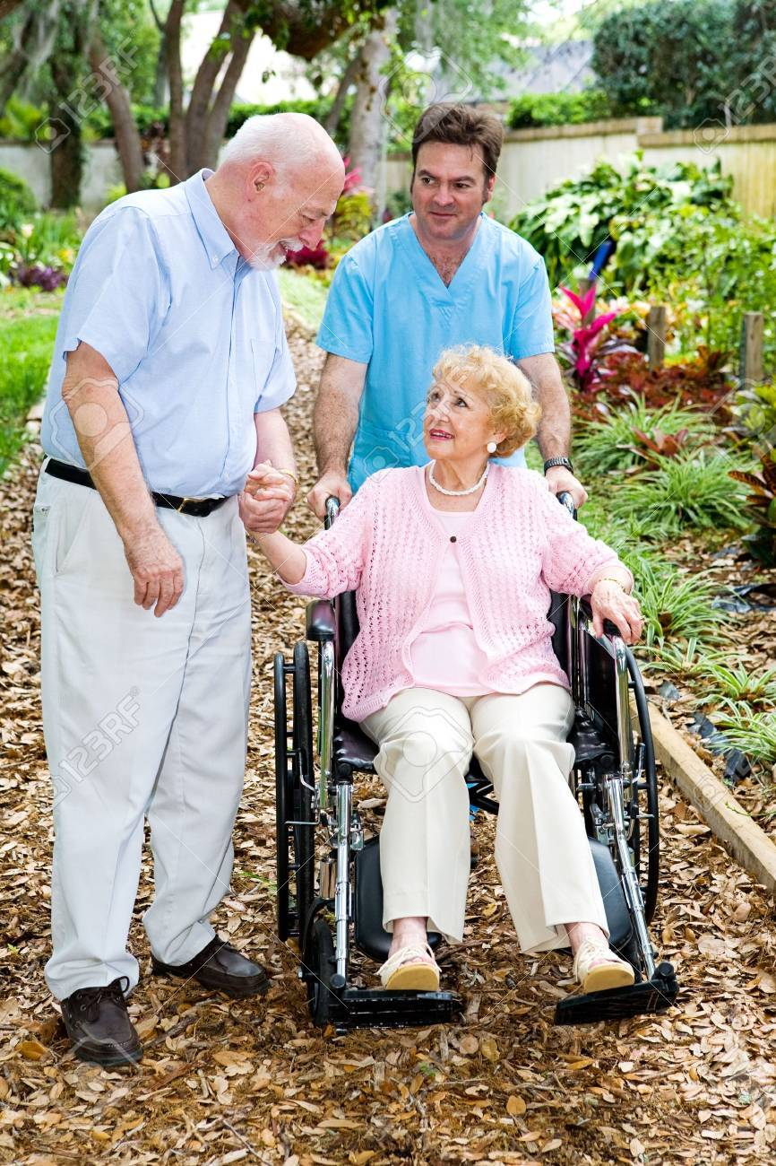 Devoted senior husband visits his wife with alzheimers disease in the nursing home. Stock Photo - 3543439