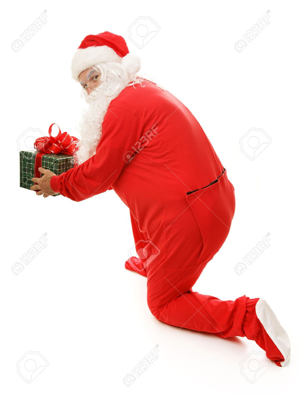50d19f938b Santa Clause in his pajamas caught in the act of setting down a gift. Full