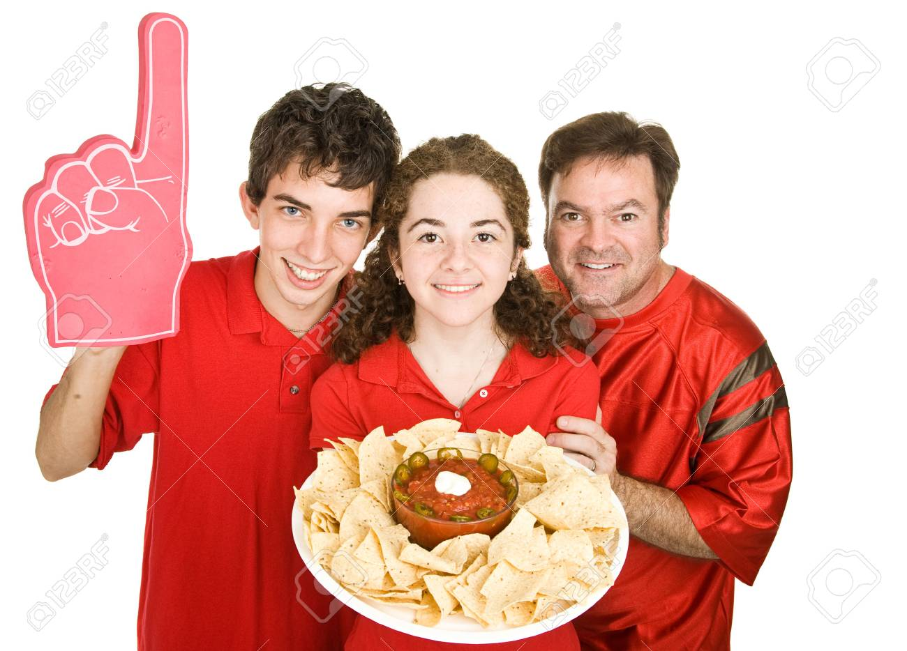 Three football fans enjoying chips and salsa during half time.  Isolated on white. Stock Photo - 3712013