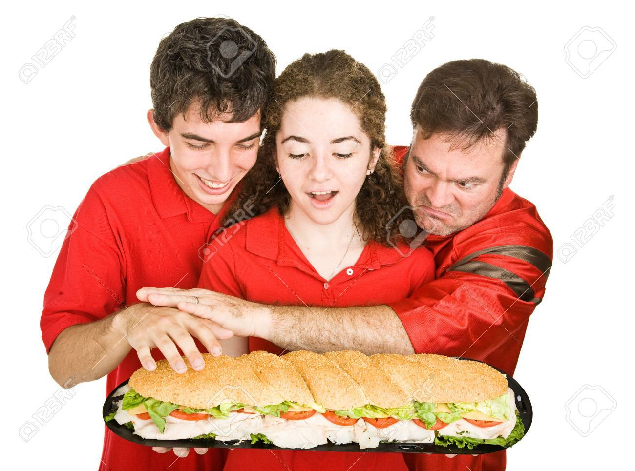Hungry sports fans fighting eachother over a giant submarine sandwich. Isolated on white. Stock Photo - 3712015