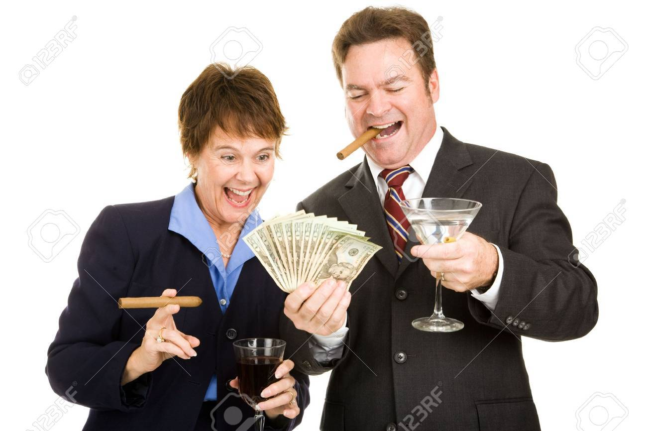 Business partners holding a wad of cash while smoking cigars and drinking cocktails.  Isolated. Stock Photo - 3913681