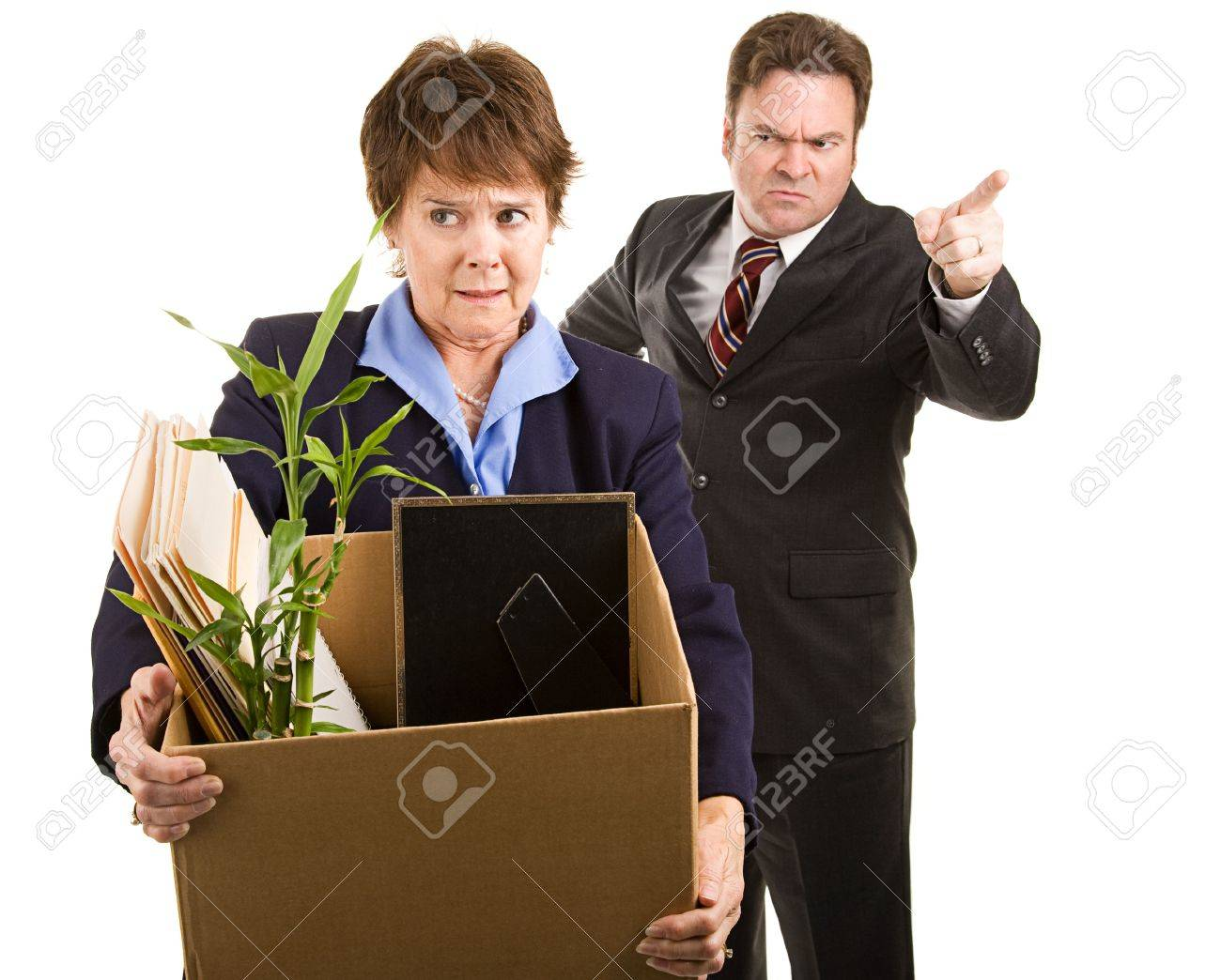 fired corporate employee holding her belongings in a cardboard fired corporate employee holding her belongings in a cardboard box as her boss orders her