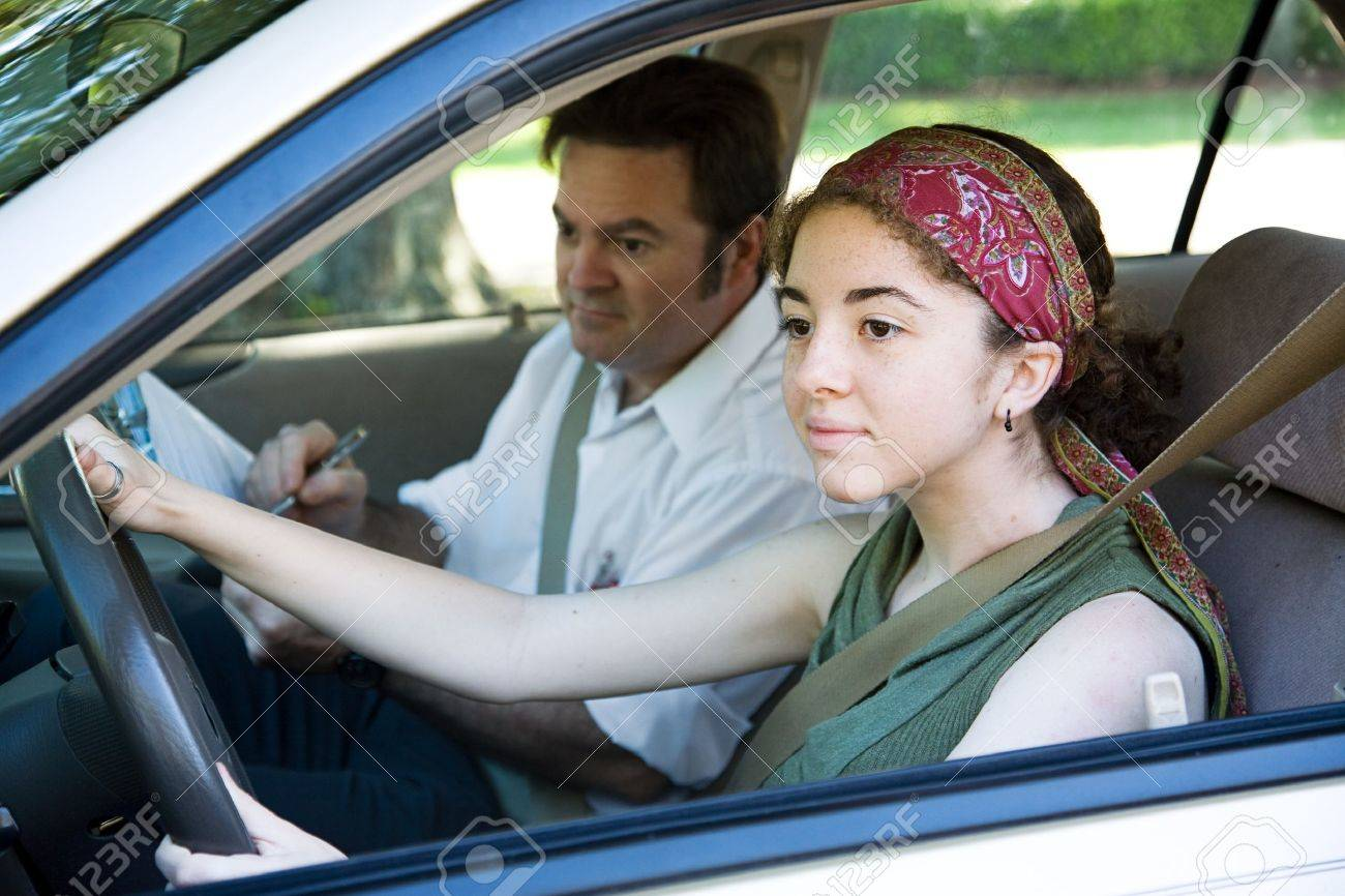 Teen girl taking driving test to get her drivers license. Stock Photo - 3993011