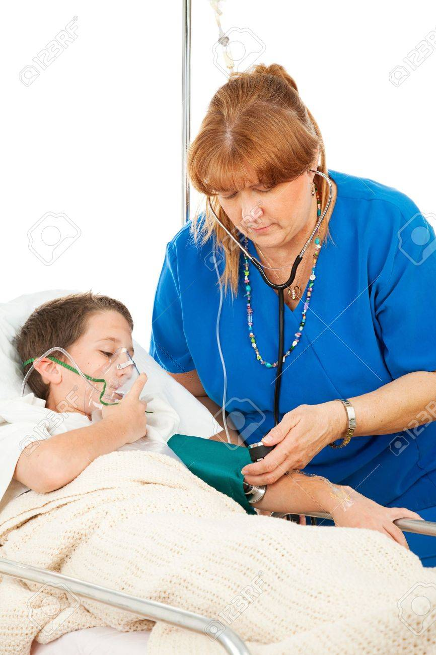 Friendly nurse takes the blood pressure of a sick little boy in the hospital. Stock Photo - 4267965