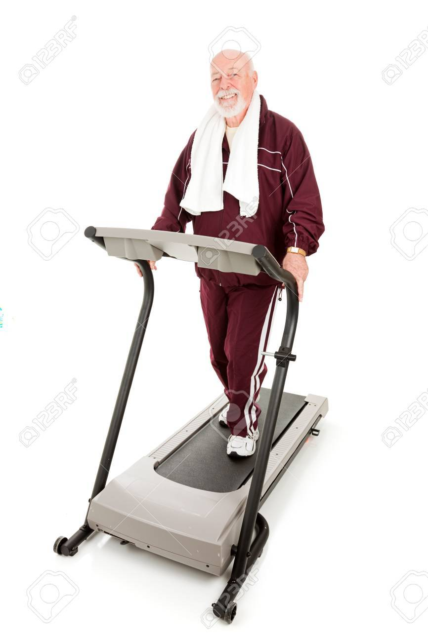 Handsome, fit senior man exercising on a treadmill.  Full body isolated. Stock Photo - 4566174