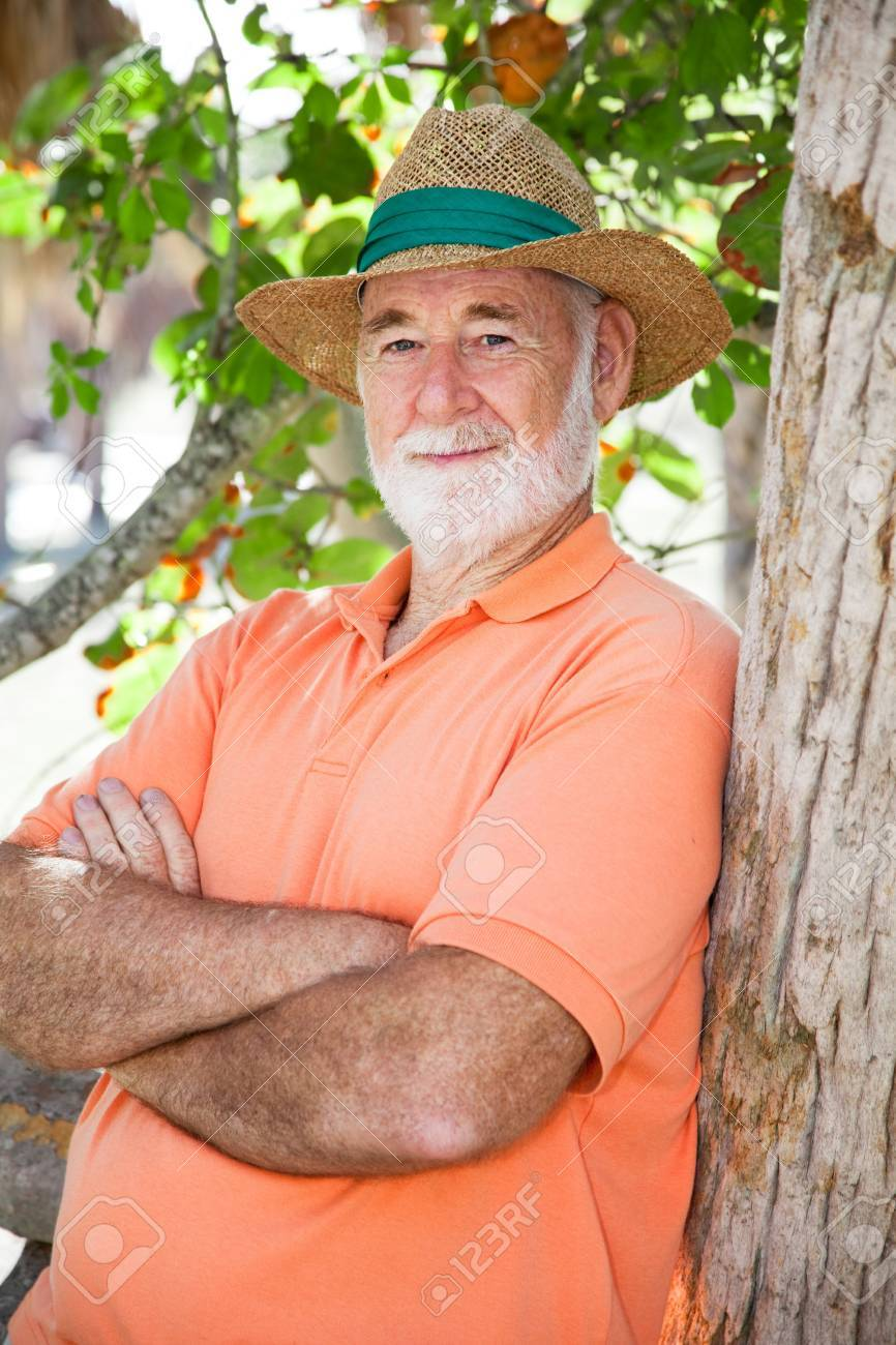 8882bed4c0c2db Handsome senior man in a panama hat with a wise, serious expression. Stock  Photo