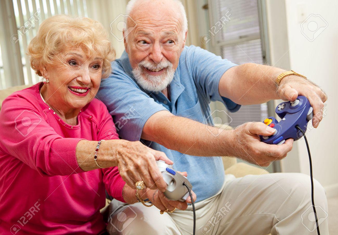 Senior couple having fun playing video games. Stock Photo - 5063130