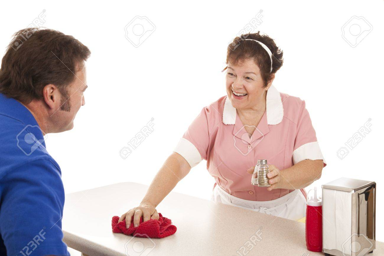 Friendly waitress cleaning the counter in a diner.  White background. Stock Photo - 5495790