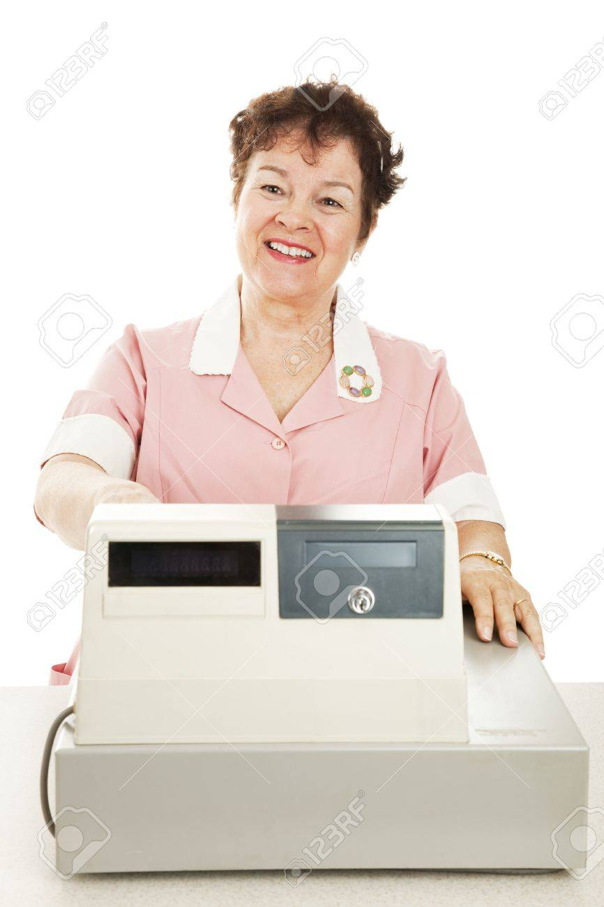 Friendly smiling cashier behind her cash register.  White background. Stock Photo - 6023361