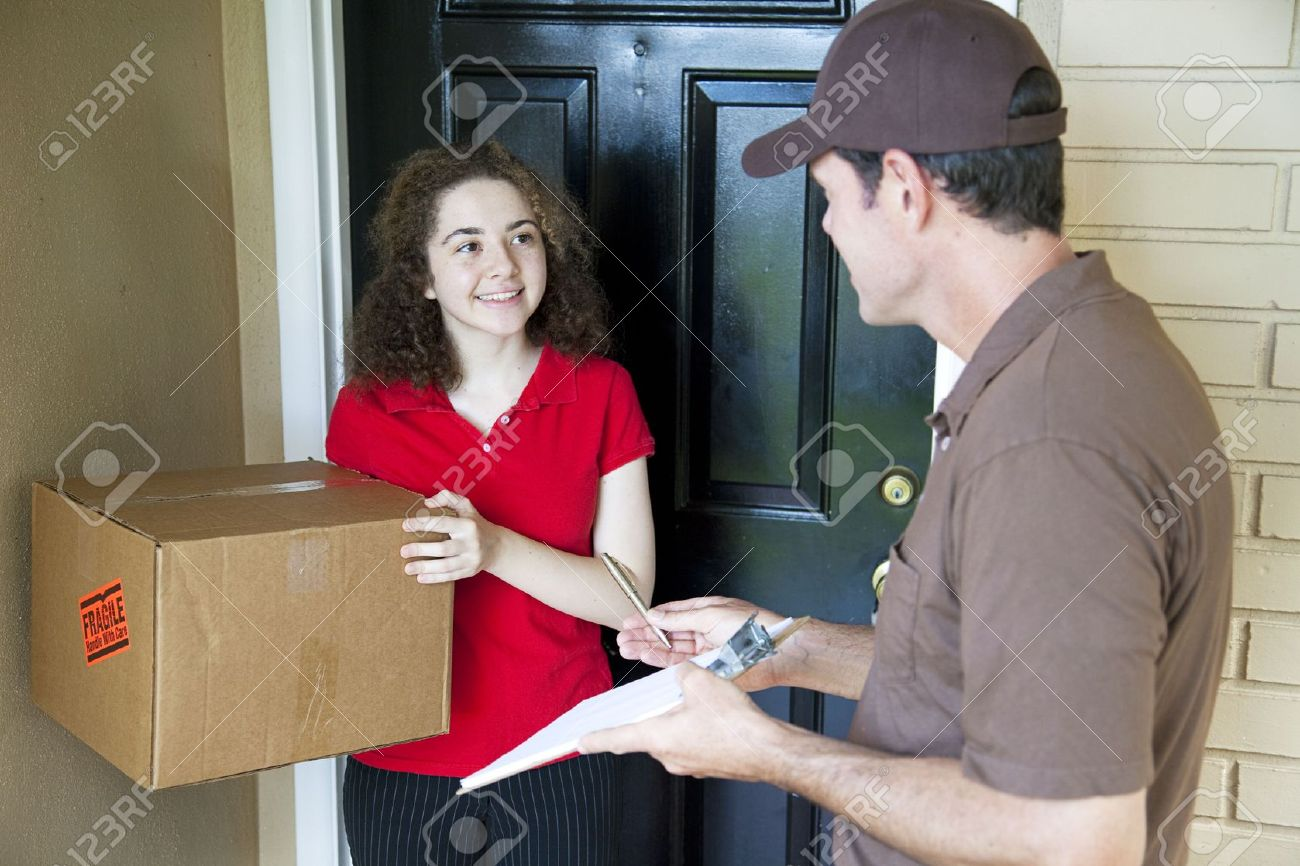 Delivery man brings a package to a customer\u0027s door and waits for a signature. Stock