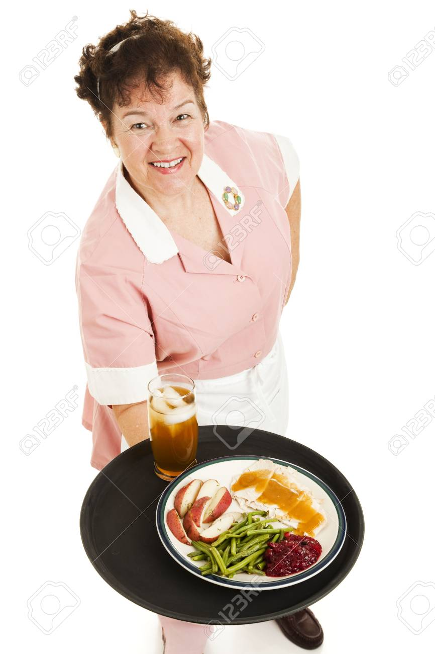 Friendly waitress serves a delicious turkey dinner and glass of iced tea.  Isolated on white. Stock Photo - 6337108