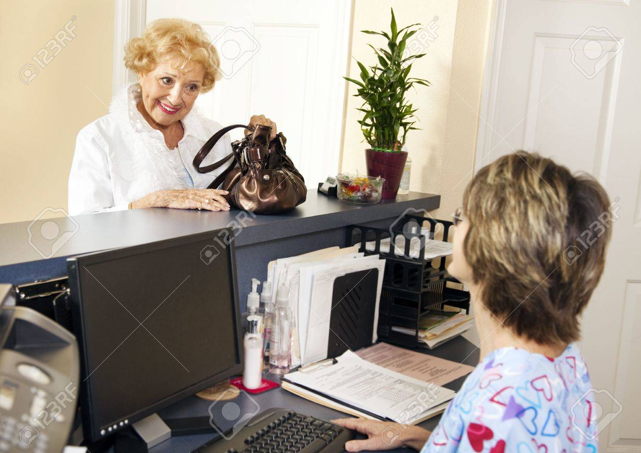Pretty senior patient checking out of the doctors office. Stock Photo - 7565752