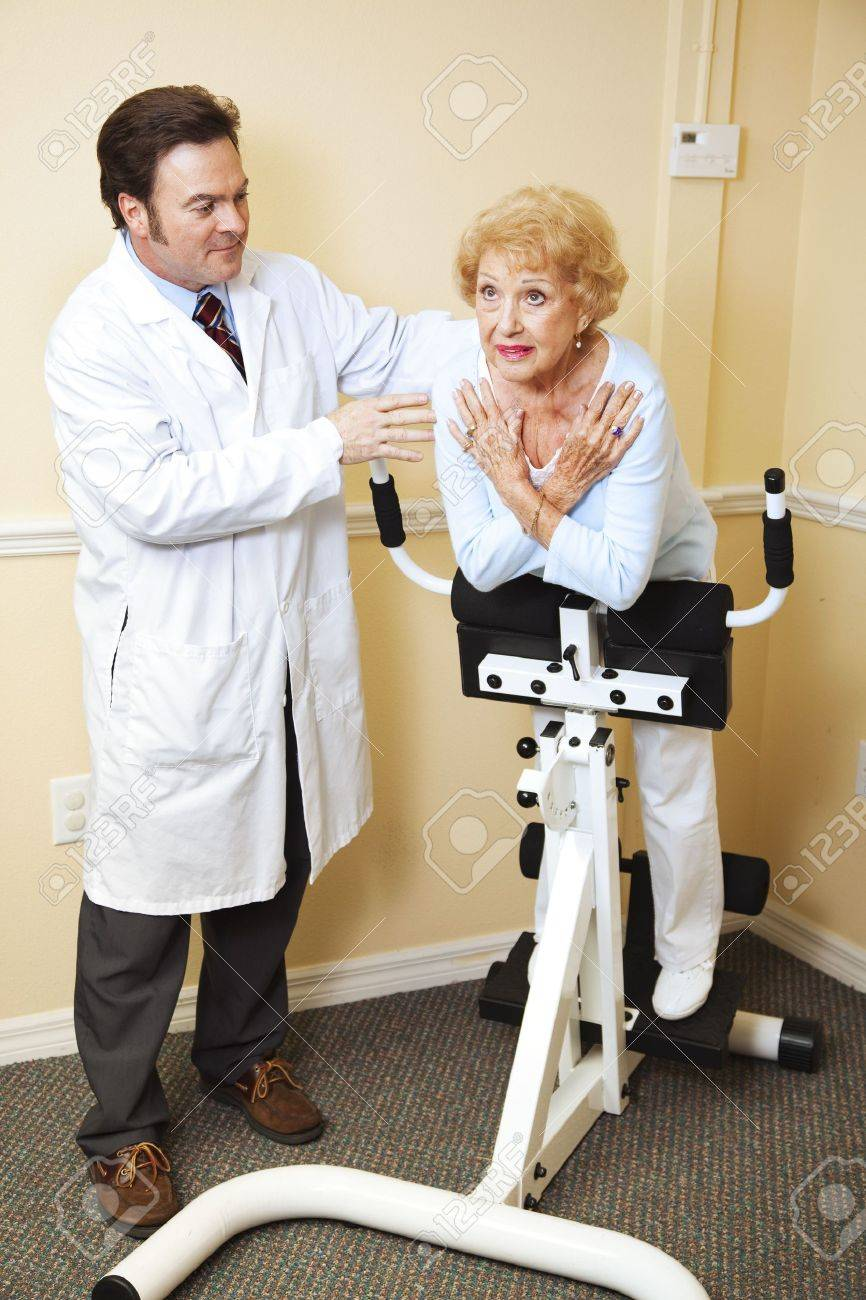 Doctor physical therapy - Chiropractic Doctor Helps Elderly Patient With Her Physical Therapy Stock Photo 6903301