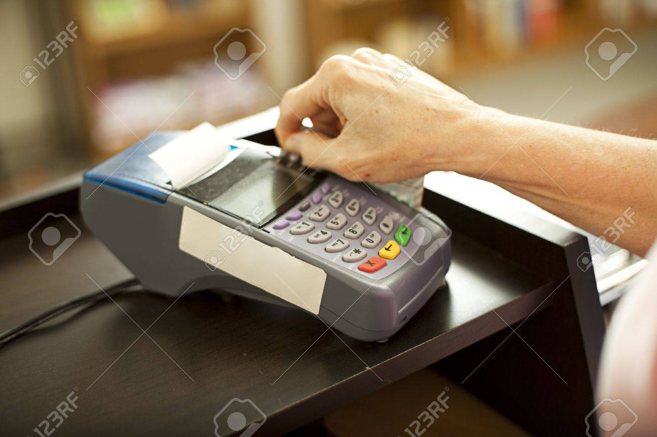 Closeup of a credit card scanning machine in use.  Shallow depth of field. Stock Photo - 7367247