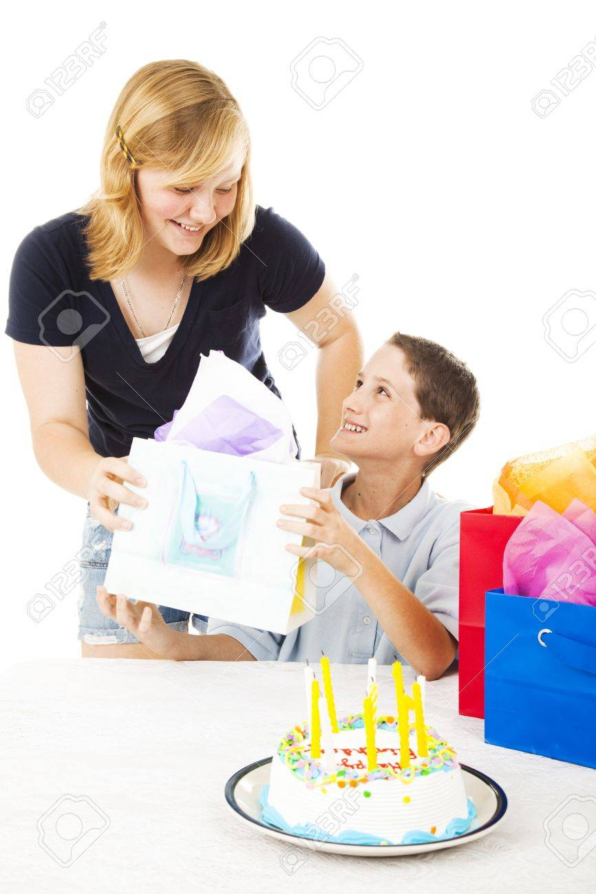 Little Boy Gets A Birthday Gift From His Older Sister White Background Stock Photo