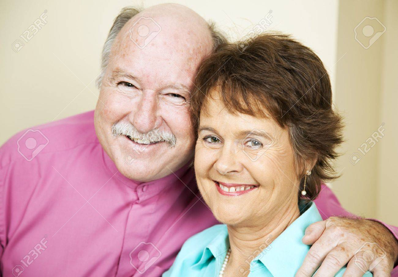 Portrait of happy, loving couple in their late fifties. Stock Photo - 7701245
