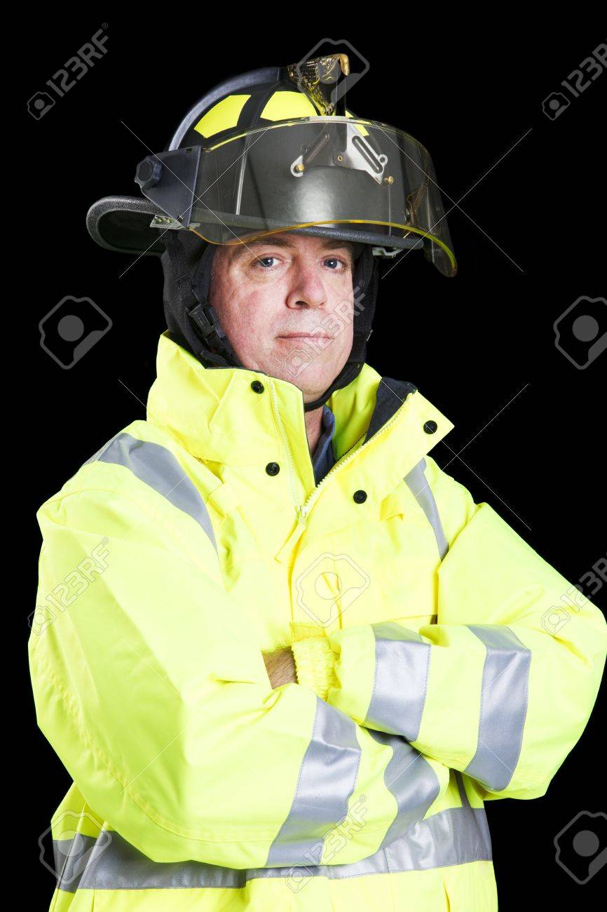 Portrait of handsome firefighter taken against a black background. Stock Photo - 8240781