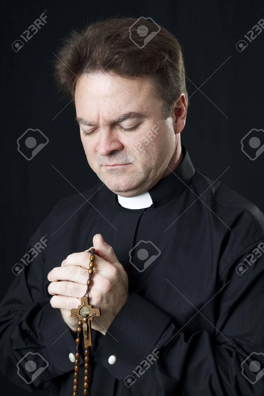 Catholic Priest Praying With