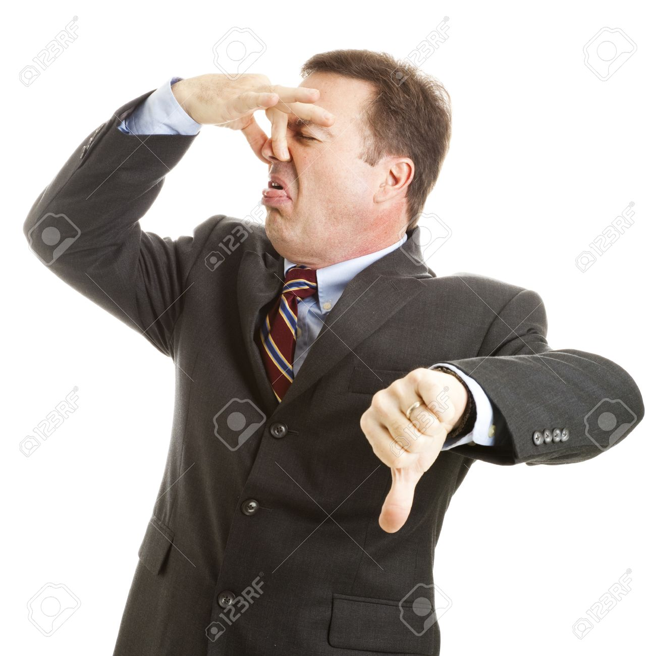 mature businessman holds his nose and gives a thumbs-down. isolated