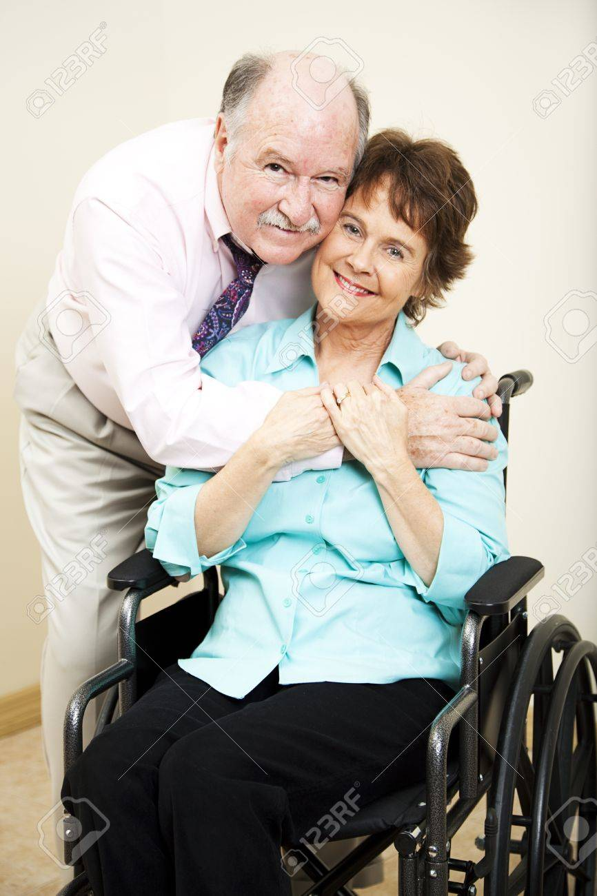 Loving, supportive husband gives his disabled wife a hug. Stock Photo - 9126791