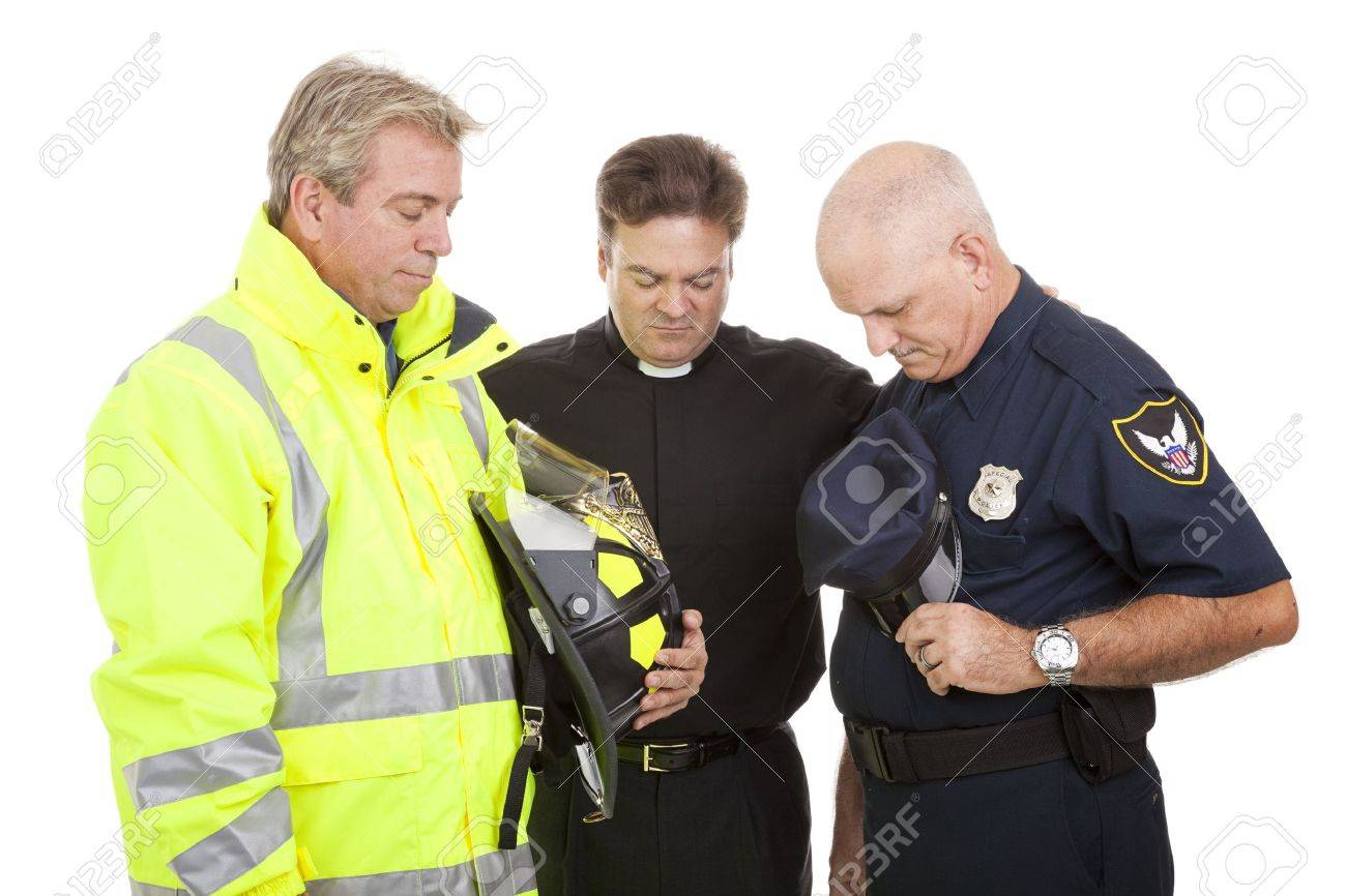 Minister prays with a firefighter and police officer at work.  Isolated on white. Stock Photo - 9418923