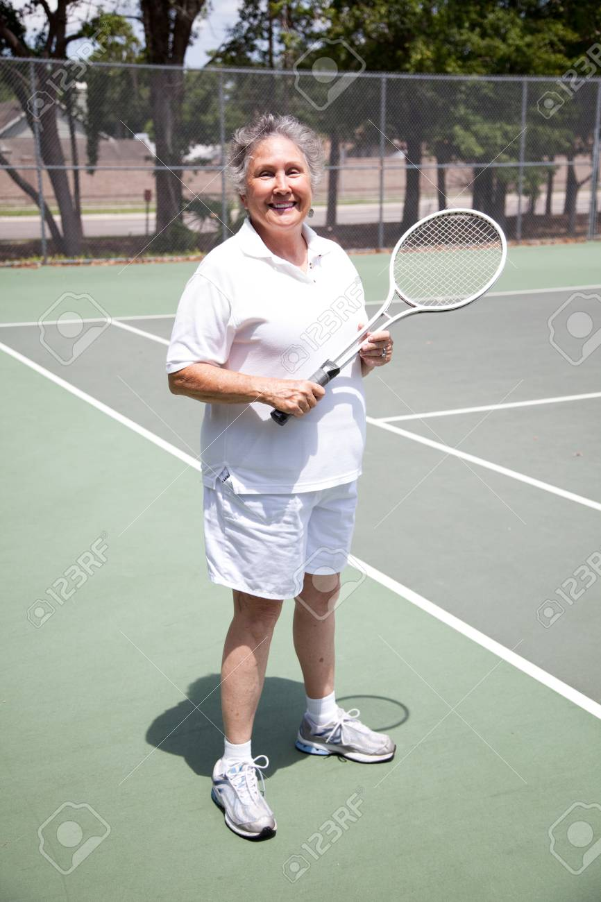 Portrait of active senior woman  on the tennis courts. Stock Photo - 9418927