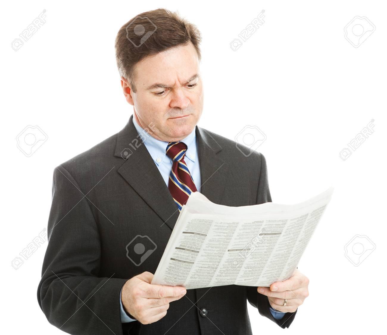 ビジネスマンは新聞で悪いニュー...