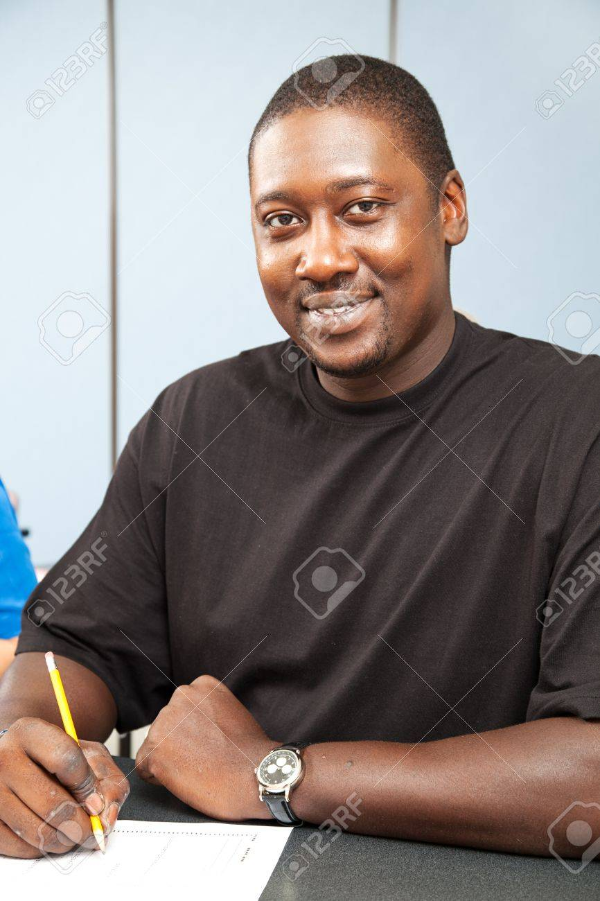 Handsome african-american college student sitting in class. Stock Photo - 10179267