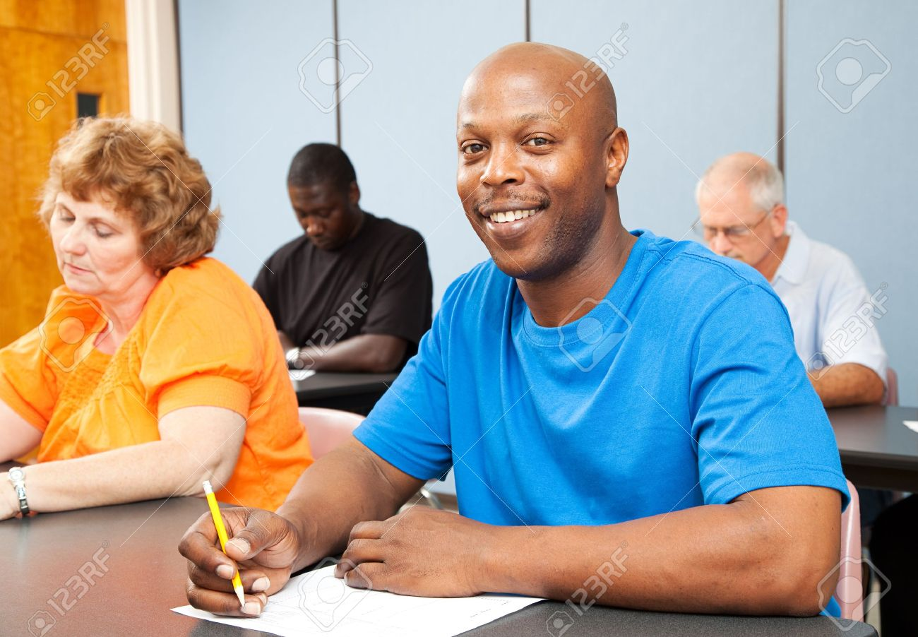 Portrait Of A Handsome African American College Student In Adult Education Class Stock Photo