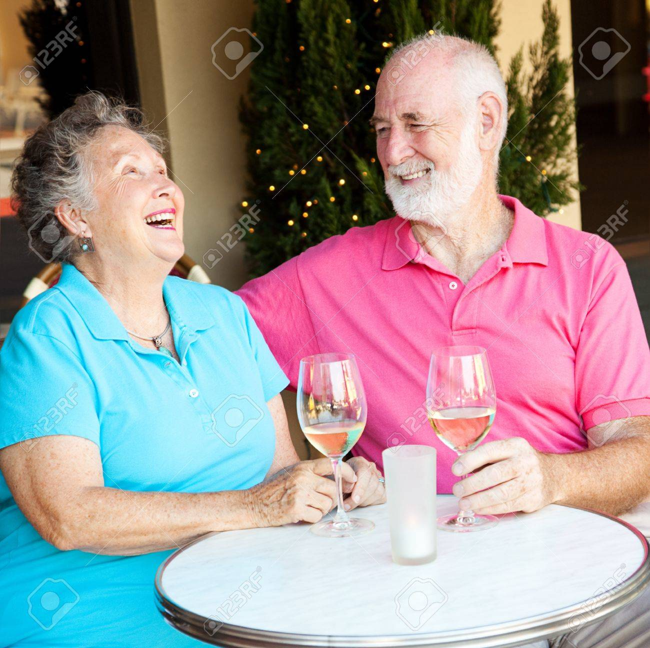 Senior couple on a date, laughing together over wine. Stock Photo - 13735946