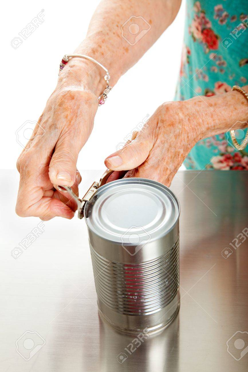 Senior woman's hands with arthritis, struggling to open a can. Stock Photo - 14971487