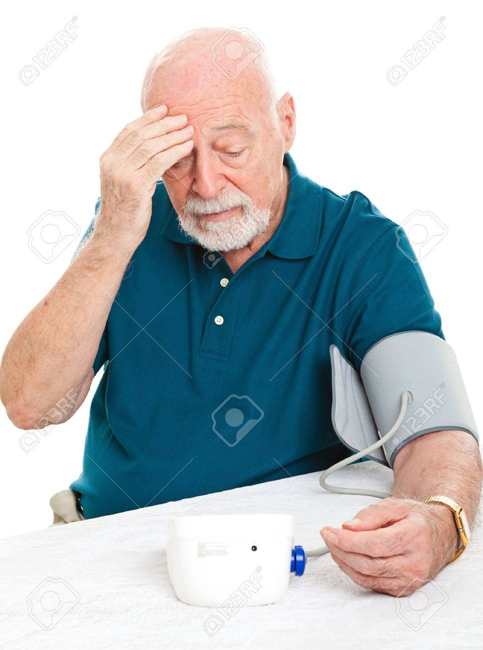 Worried senior man monitors his blood pressure at home. Stock Photo - 14943211