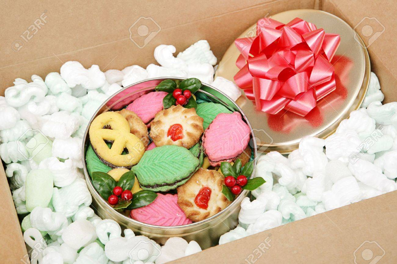 A tin of Christmas cookies being shipped by mail. Stock Photo - 16246661