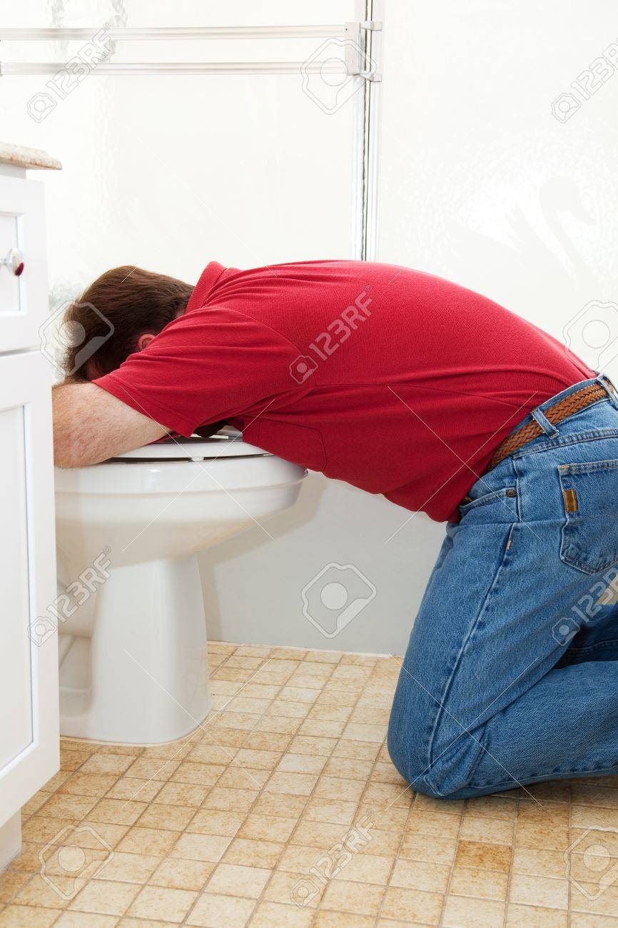 Man in the bathroom, vomiting into the toilet. Stock Photo - 19809634