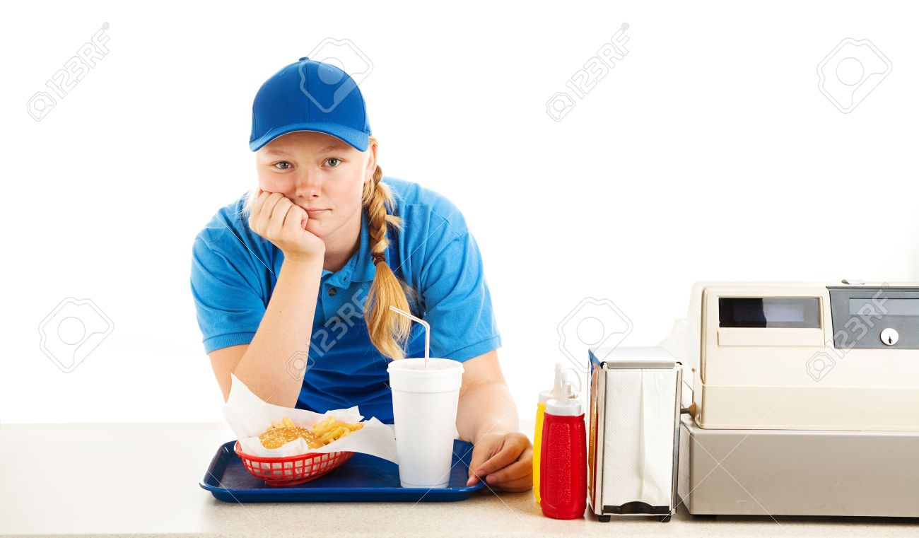 food server stock photos pictures royalty food server food server teenage worker in a fast food restaurant bored and leaning on the counter