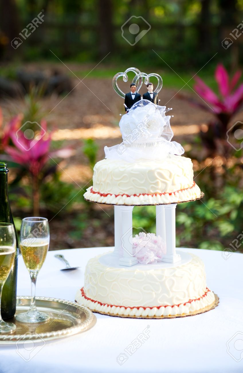 Wedding Cake And Champagne Set Up On A Table In The Garden. .. Stock ...