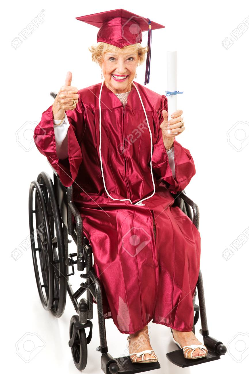 Senior lady in a wheelchair earns her college degree and gives a thumbs up.  Full body isolated on white. Stock Photo - 23950285