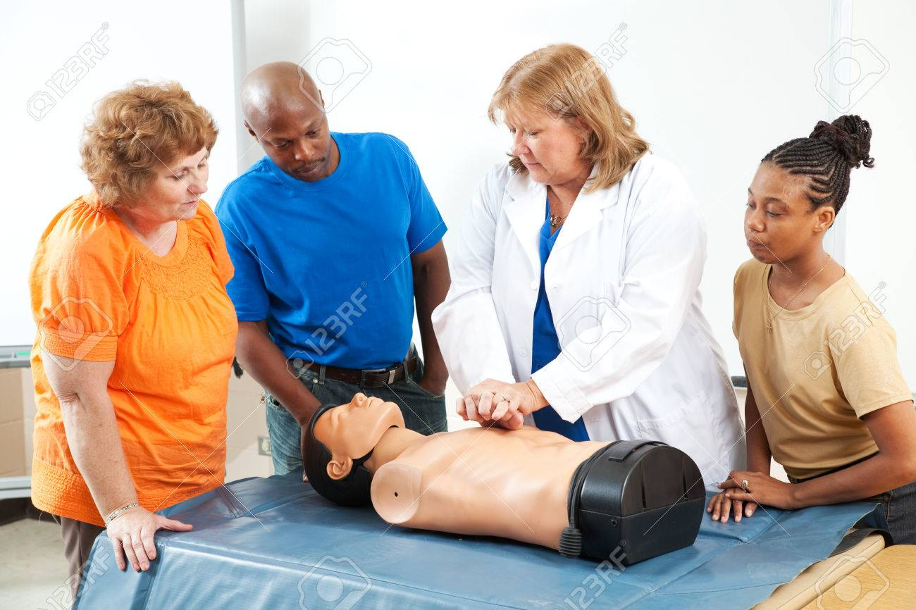 Adult education students learning CPR and first aid from a doctor or nurse. Stock Photo - 25913429