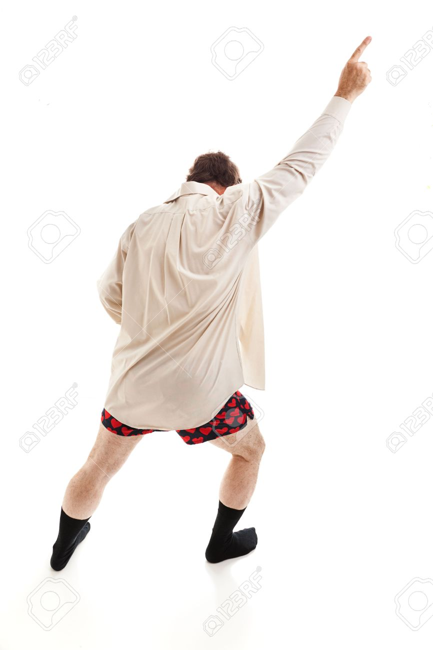 Middle aged man dancing around in his socks, shirt, and underwear,