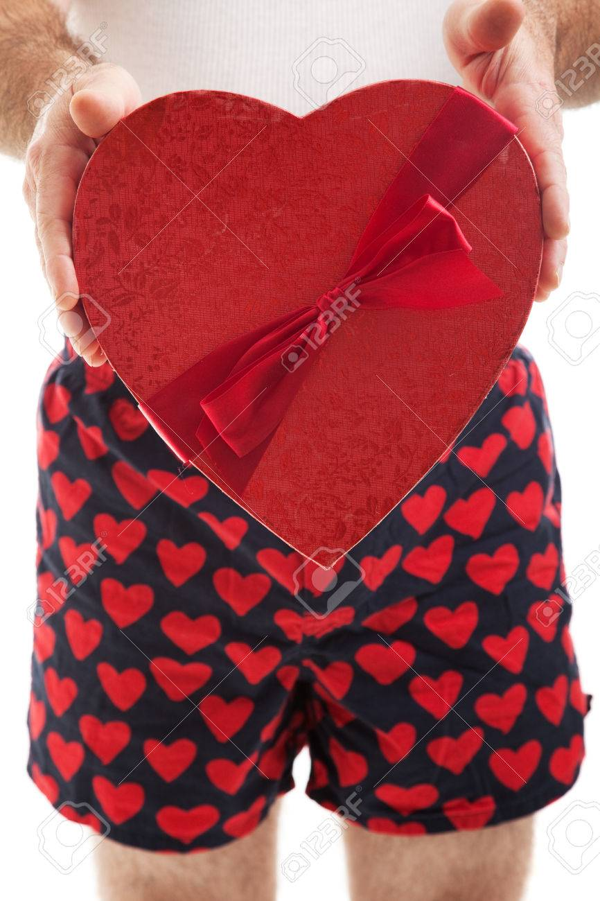 Guy In His Heart Boxer Shorts Giving A Valentines Day Box Of Stock