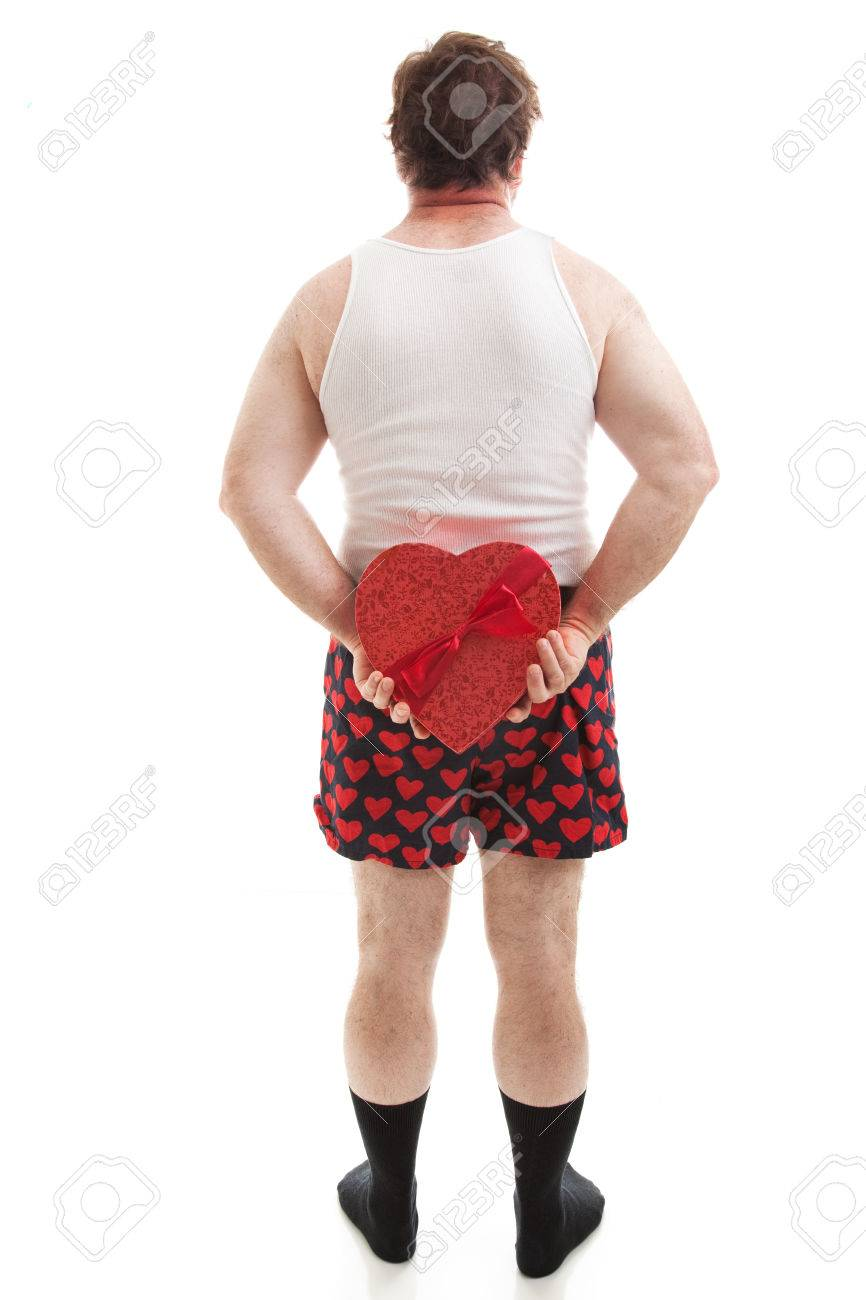 Guy In Heart Underwear Holding A Valentines Day Heart Shaped Stock