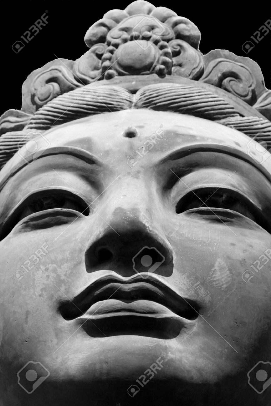 Black white close up of one of the six the offering of the six devas statues