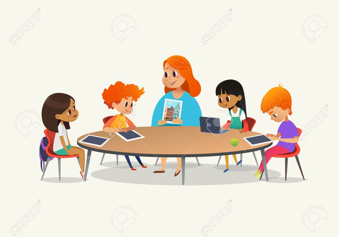 Redhead female teacher showing picture to children sitting around round table at class with laptop and tablet pc. Kids using gadgets during lesson at primary school. Colorful vector illustration - 91335910