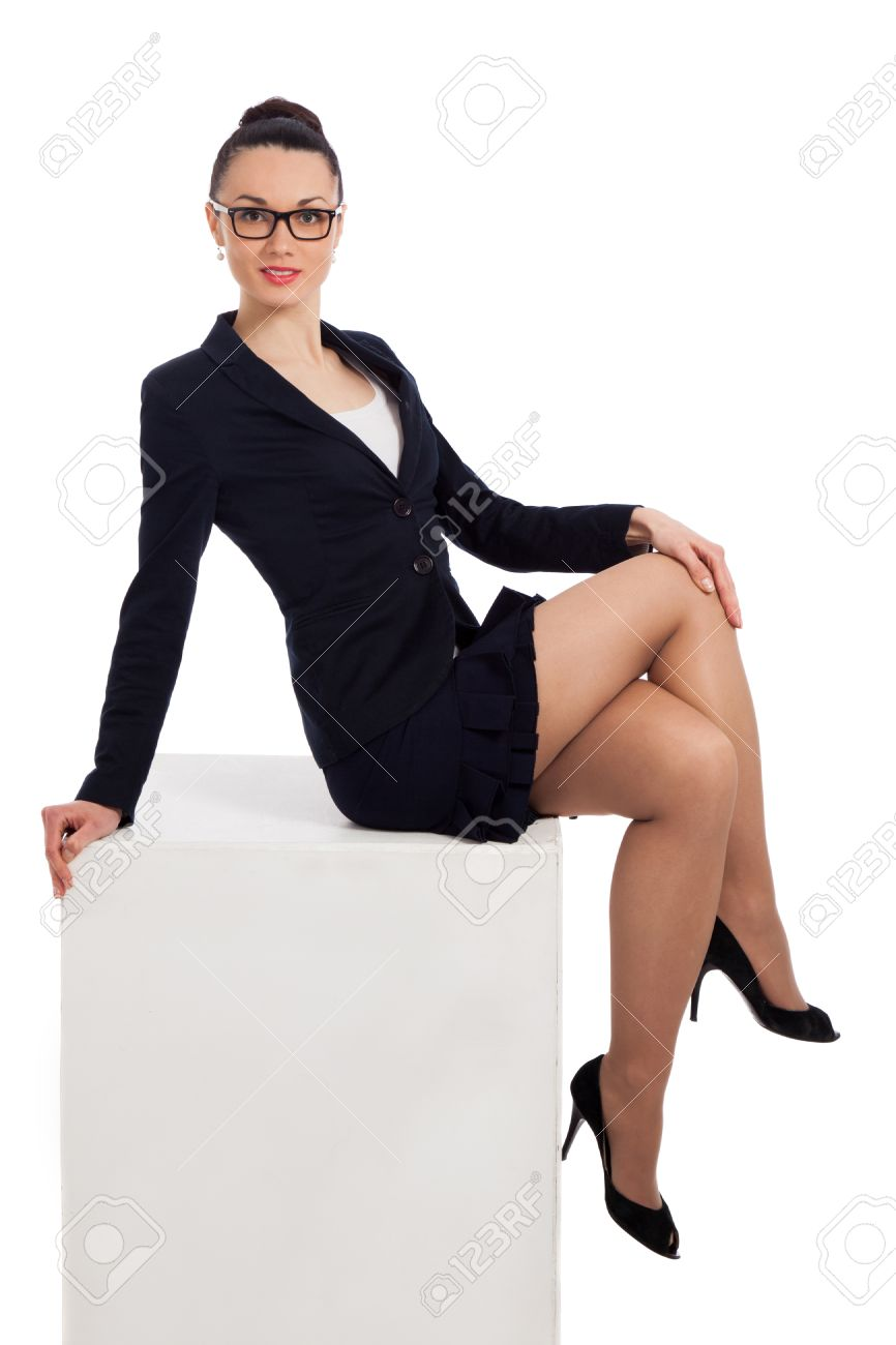 Brunette Woman In Black Skirt And Jacket Sitting On The White ...