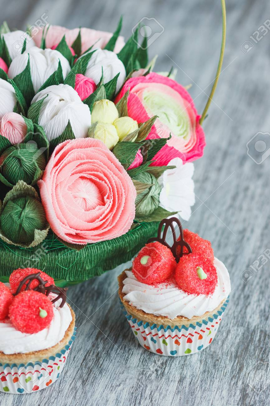 Bouquet from colored paper flowers and cupcakes soft focus bouquet from colored paper flowers and cupcakes soft focus background stock photo 97025257 izmirmasajfo