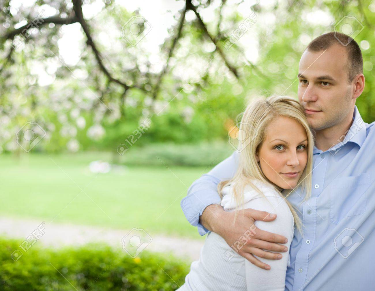 Romantic portrait of attractive young couple out doors in nature. Stock Photo - 9420246