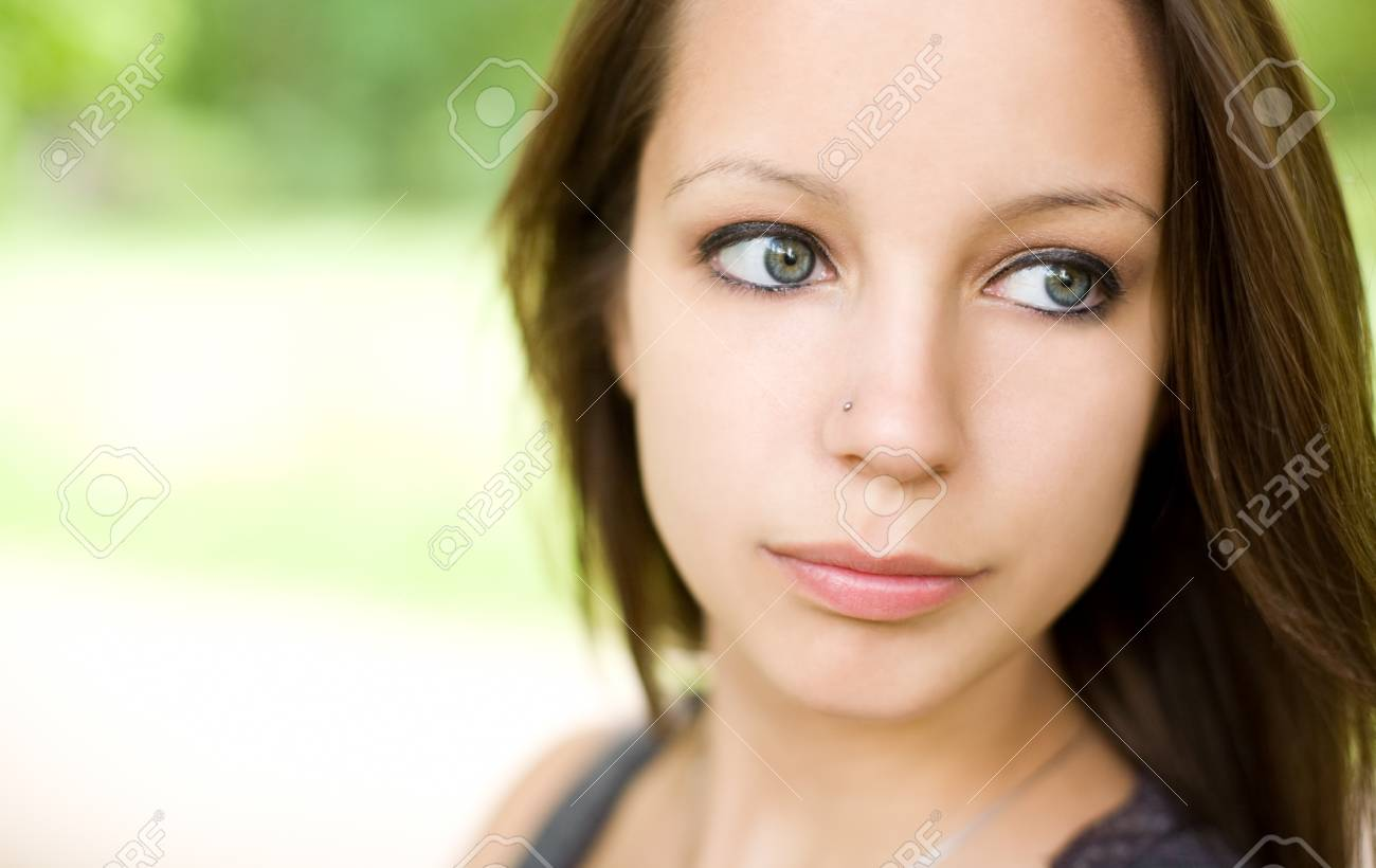 Romantic emotional portrait of beautiful young brunette girl. Stock Photo - 9756151