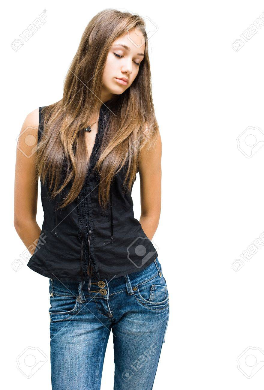 Portrait of a beautiful young brunette girl  posing in jeans isolated on white background. Stock Photo - 11423377