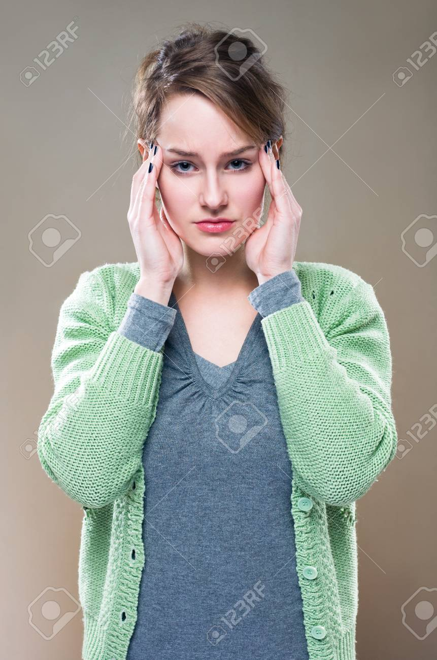 Half length portrait of a young brunette woman with terrible headache... Stock Photo - 11862834